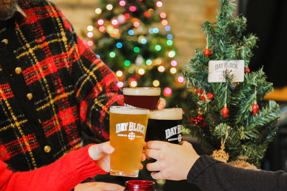 cheers at a holiday party in our taproom