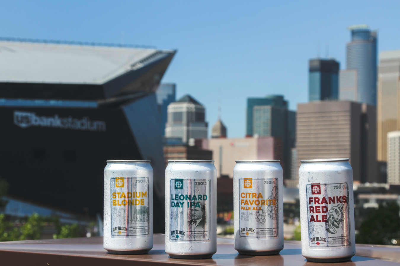day block brewing's crowlers infront of downtown minneapolis skyline