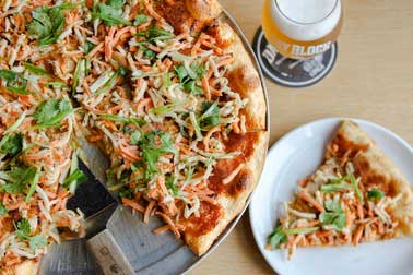 Day block's top selling pizza the banh mi